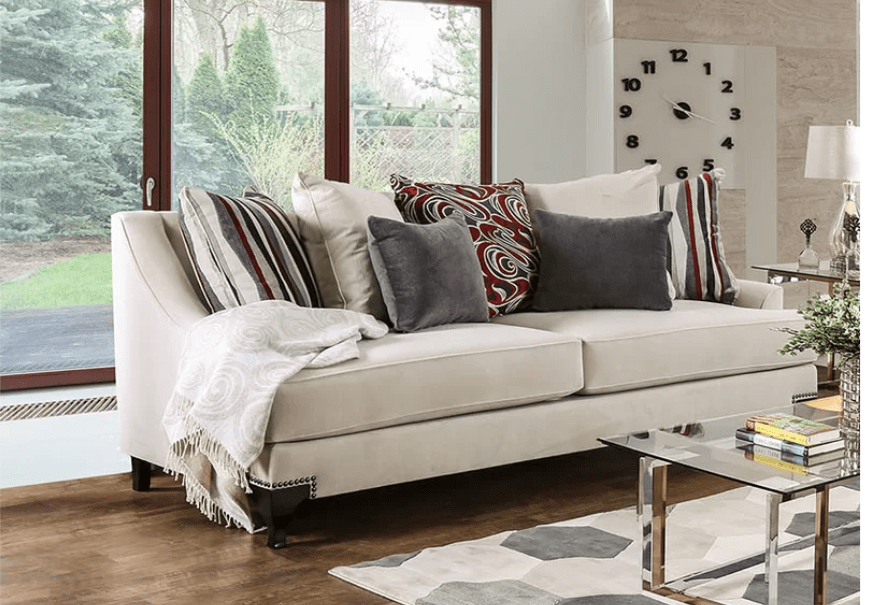 Off white sofa with downward curving arms and exposed wood legs