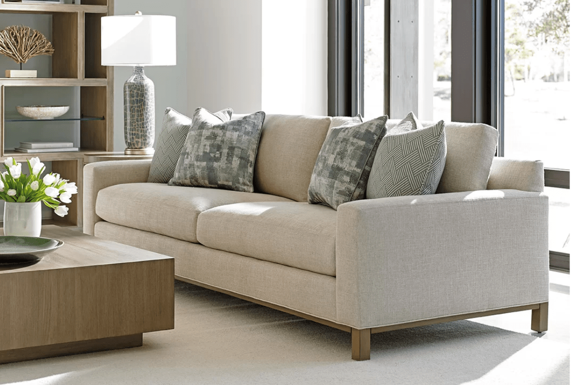 Deep beige sofa in plan design with detachable back cushions and round wood legs