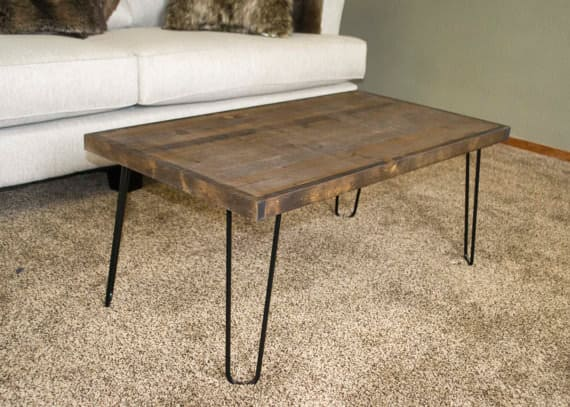Natural wood topped coffee table with metal wire legs