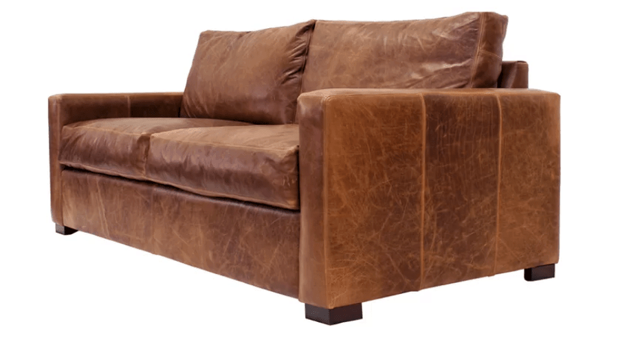Distressed leather rustic sofa with chunky wooden legs
