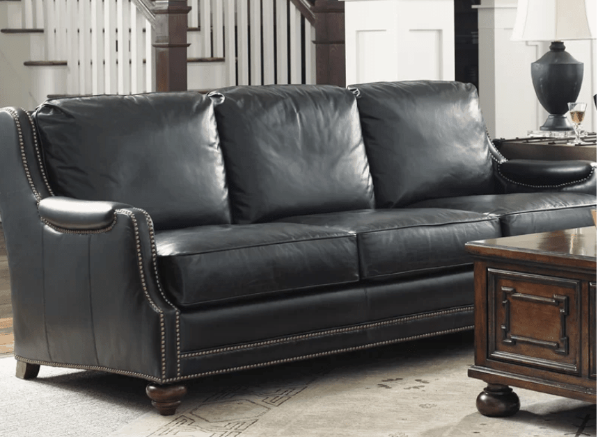 Black leather sofa with nailheads