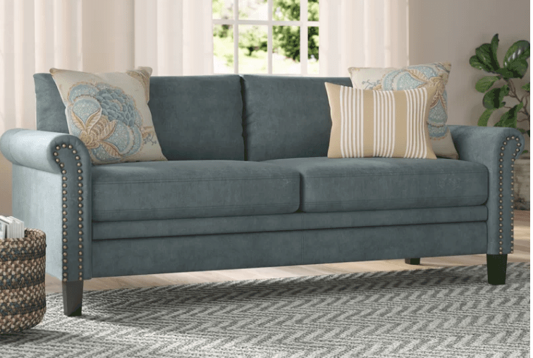 Blue gray sofa with exposed wooden legs