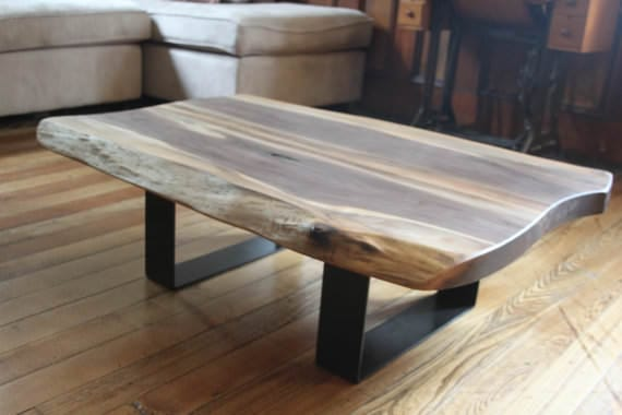 Large dark and light wood coffee table with thick metal frame legs