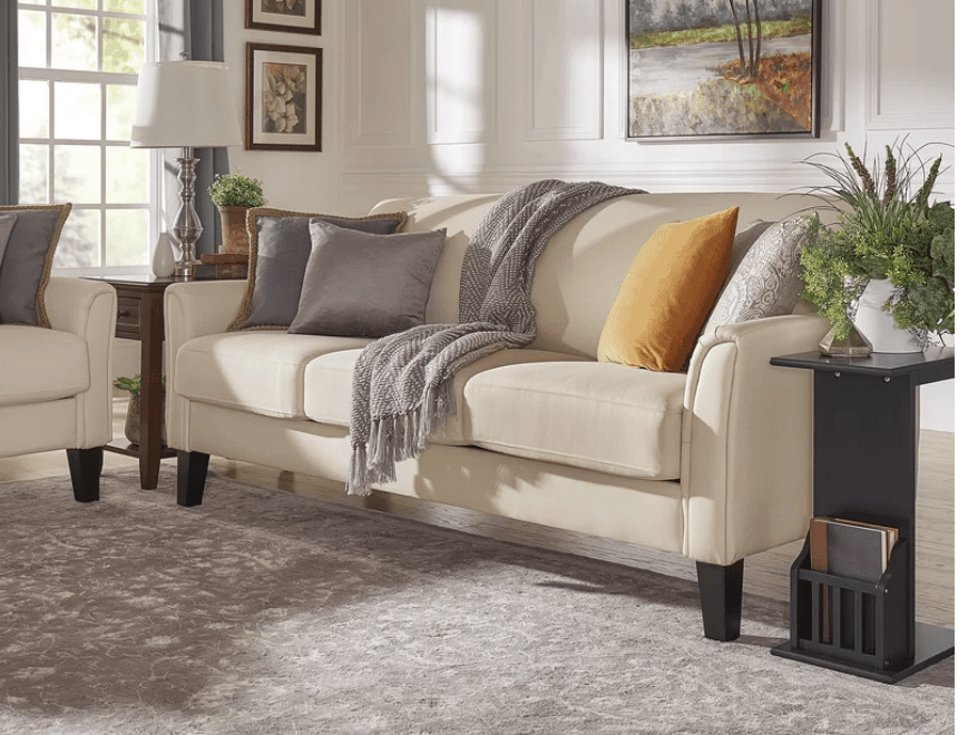 Elegant off-white curved arm sofa with long exposed wood legs