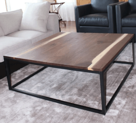 Large square wood-topped coffee table with metal frame legs