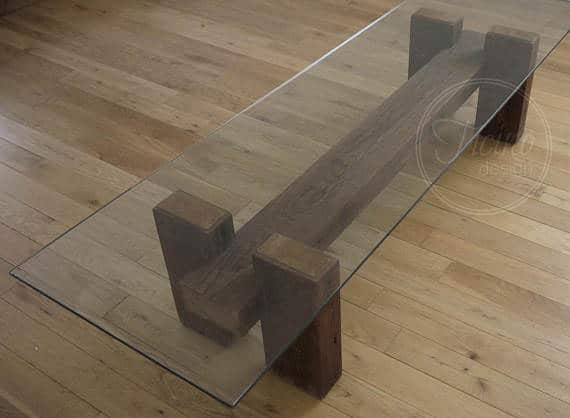 Glass topped coffee table with solid wood legs