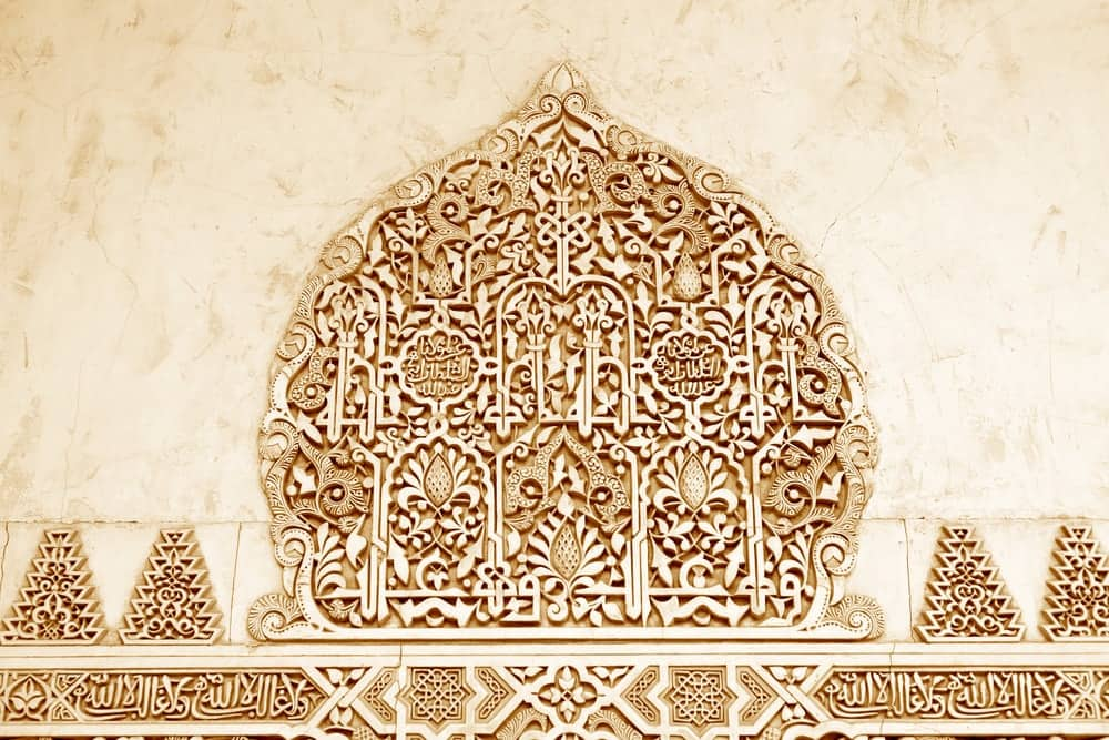 Arabic writings in a palace wall in the Alhambra complex.