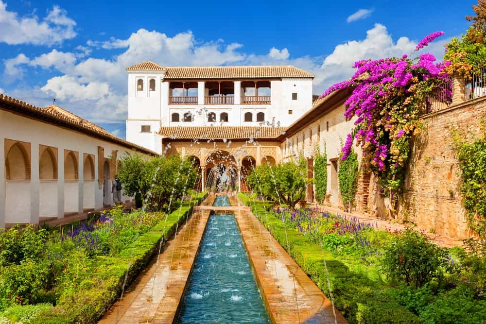 The Generalife courtyard with its famous fountain and garden in Alhambra Palace.