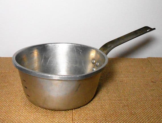 A small vintage aluminum sauce pan made by Wear Ever.