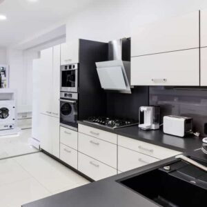 A display of home appliances in a monochrome interior.