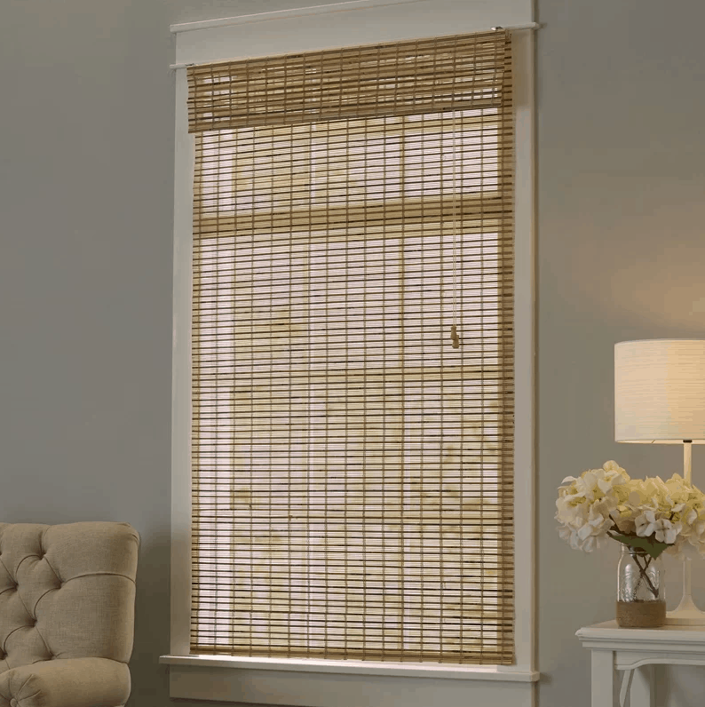 Crafted of bamboo and showcasing a timeless Roman design, this lovely shade keeps the sun at bay.