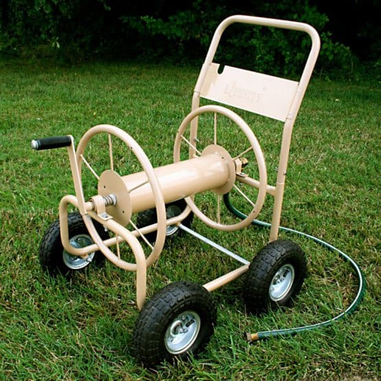 Beige, four-wheeled cart with hose storage.