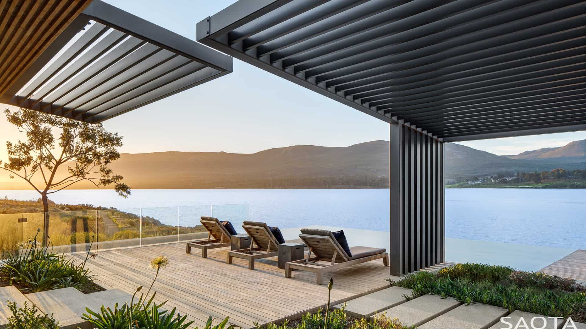 This deck offers a comfortable lounger seats overlooking the hills and river.
