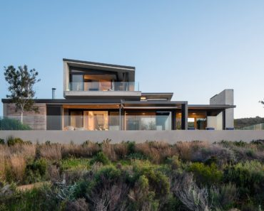 The home's outdoor view features its amazing building structure and landscaping. Photo Credit: Adam Letch