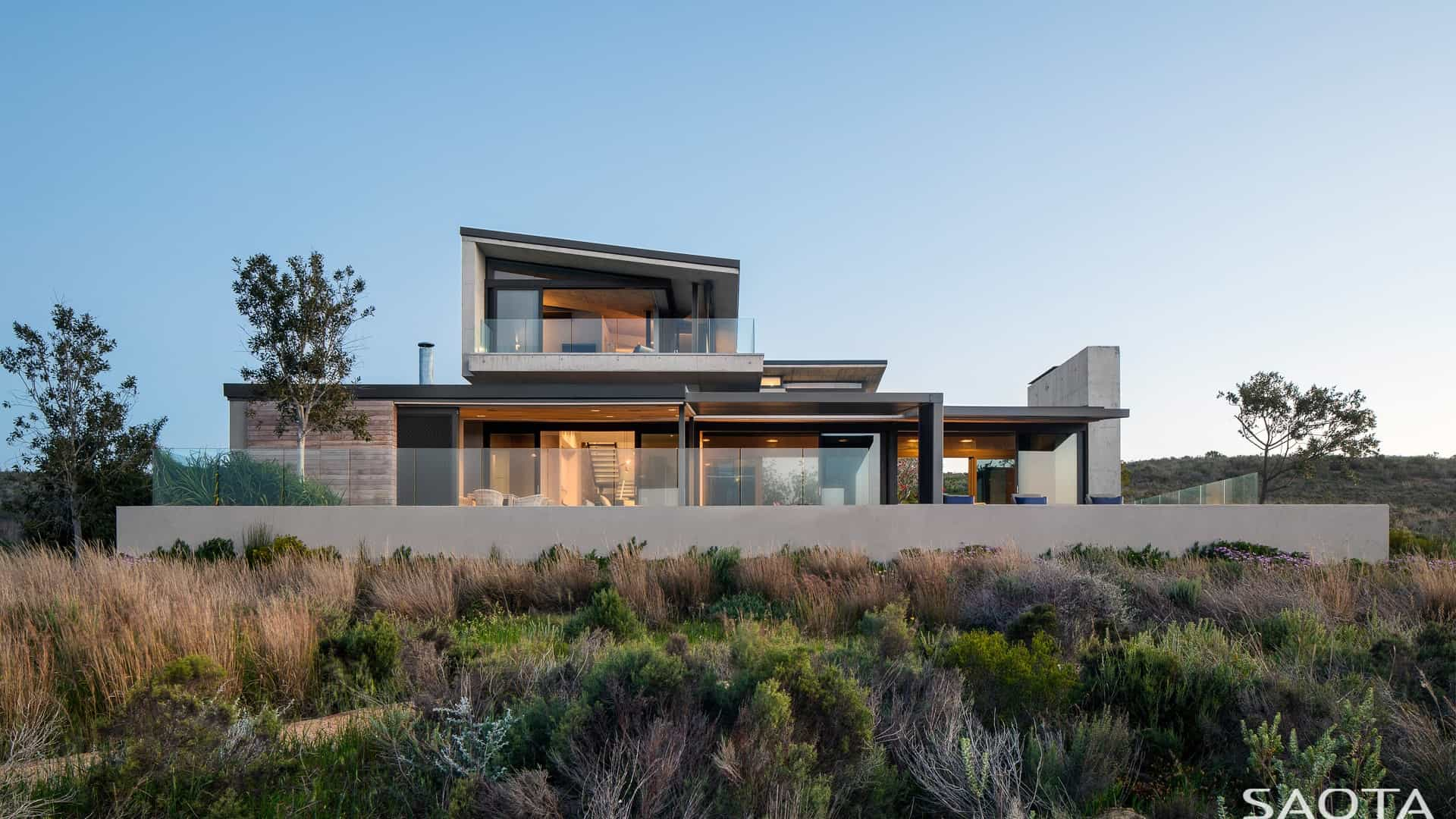 The home's outdoor view features its amazing building structure and landscaping.