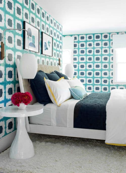 Another look of the girls bedroom focusing on its huge bed, side table and wall decors. Photo Credit: Raquel Langworthy