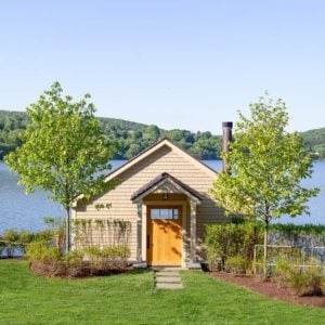 Berkshire lake house's outdoor view featuring a beautiful lawn and plants. Photo Credit: Raquel Langworthy