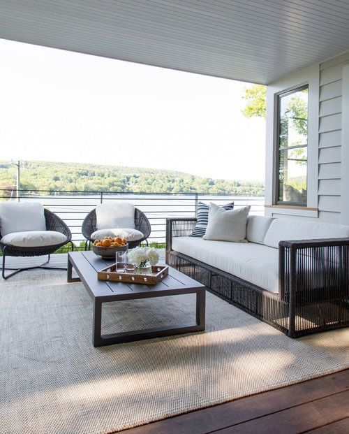 The patio is complete with a sofa set and a center table on top of a rug. Photo Credit: Raquel Langworthy