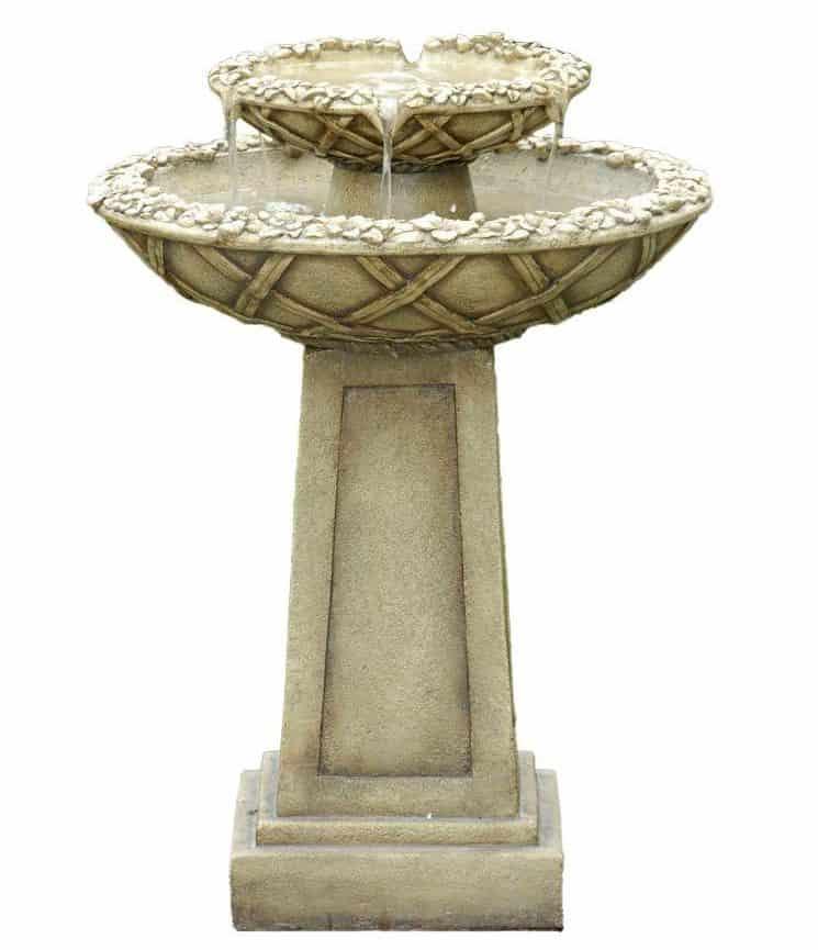 A bird bath water fountain in a fiberglass construction.