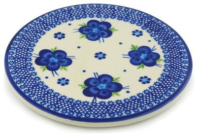 Stoneware cutting board with blue flowers and details.