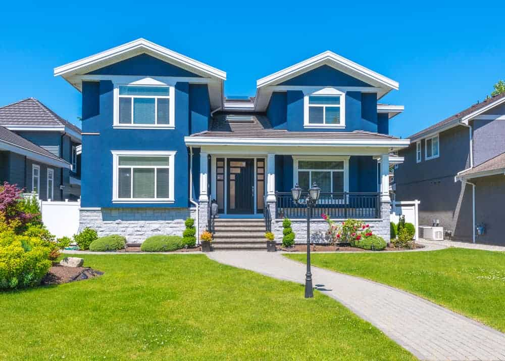 Bright, dark blue with white trim and some light gray stonework make up the this home's exterior. The blue is a tad bright for me, but it does provide some color to the neighborhood.