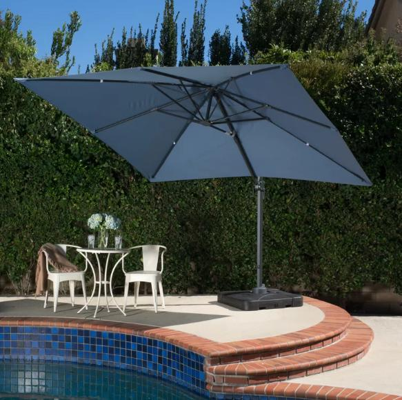 A large, square-shaped patio umbrella in deep blue.