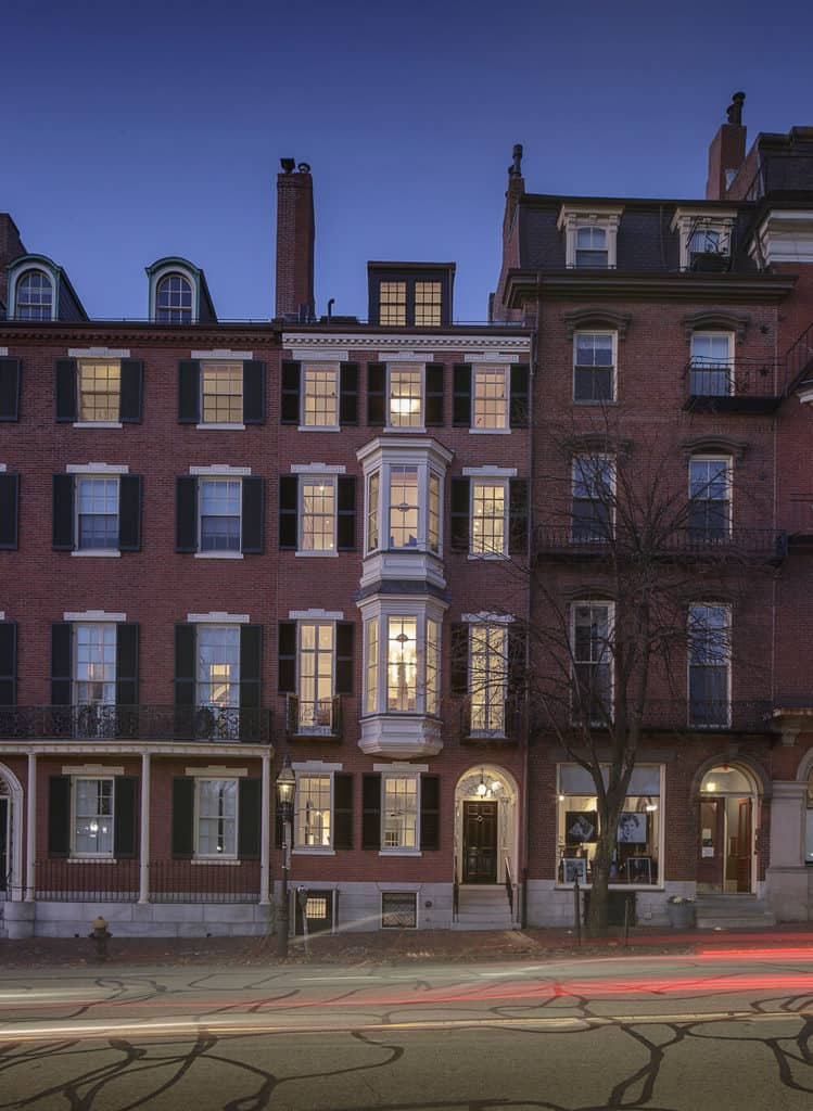 A common townhouse in Boston featuring a red brick exterior.