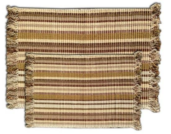 A 2-piece set of brown ribbed doormats made out of weaved bamboo.