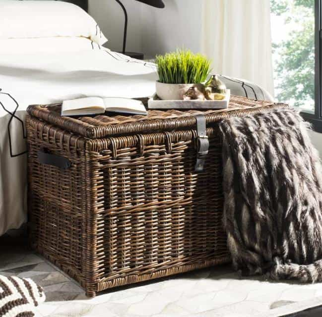 A wicker storage trunk that doubles as a living room table.