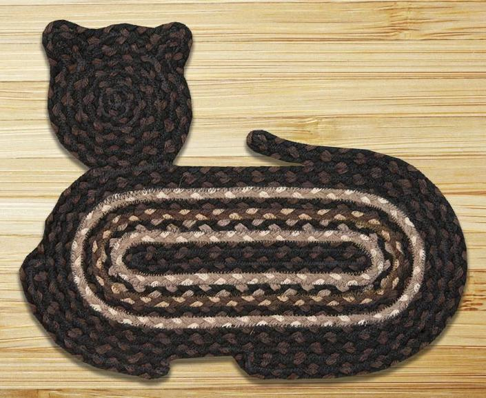 Cat-shaped mat in different tones of brown and nude.