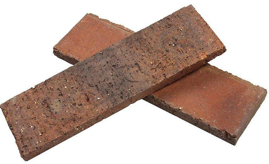 Thin and flat, clay brick.