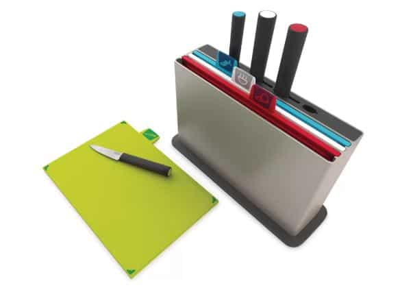 Colorful cutting board set with knives included.