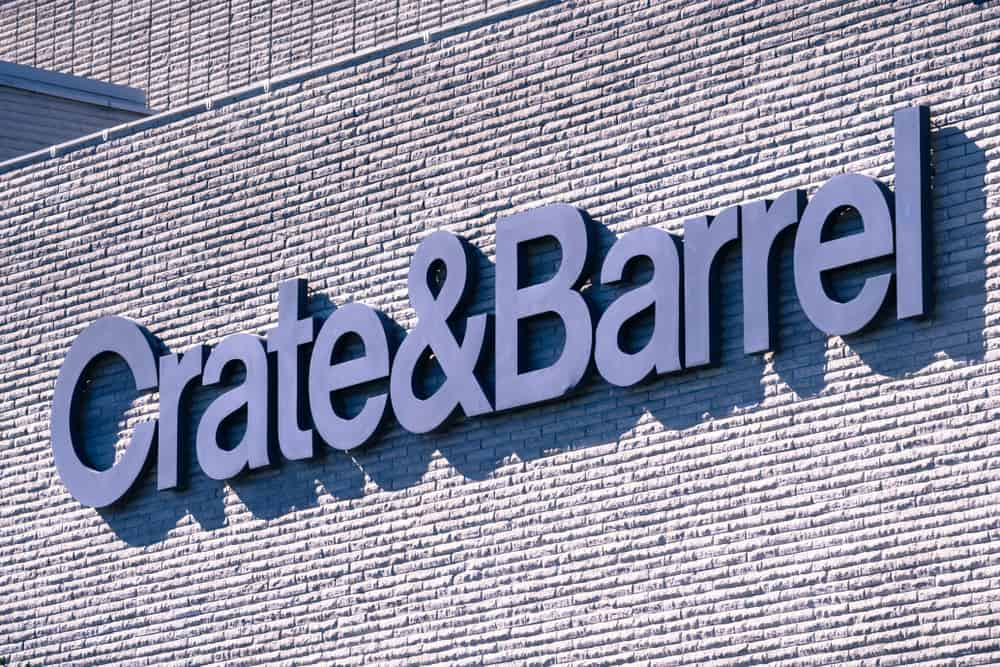 Closeup of Crate&Barrel company name as seen on a brick building exterior.