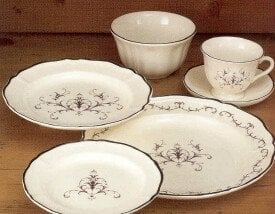 Wedgwood Queen's Filigree creamware plate design pattern features subtle etching and filigree like scrolls in shades of brown on a creamy background to create a look that is both airy and delicate.
