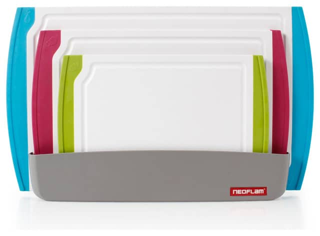 A set of white cutting boards with colourful accents.
