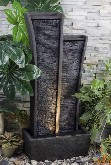 A dark gray, waterfall fountain with a modern finish.