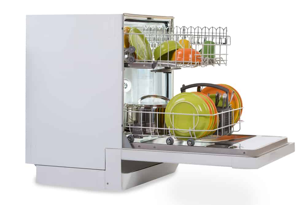 White dishwasher full of dishes.