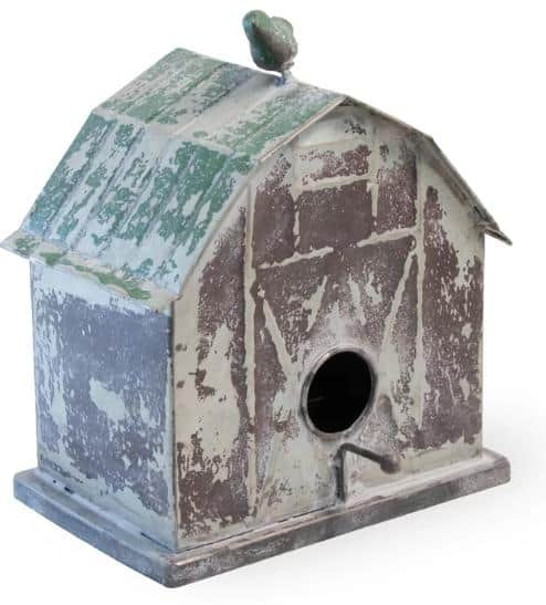 A distressed birdhouse made of metal.