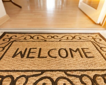 "A doormat in a medium Tan shade with a ""Welcome"" text design."