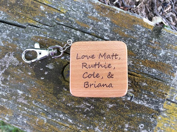 A maple wood tape measure and can be customized to whatever you would like engraved on it.