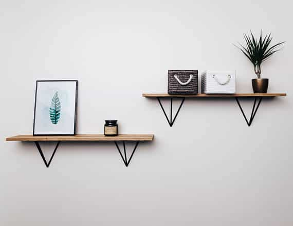 Floating shelves braced with triangle metal braces