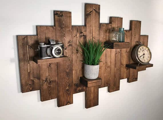 Wood floating shelves from Etsy with wood board background