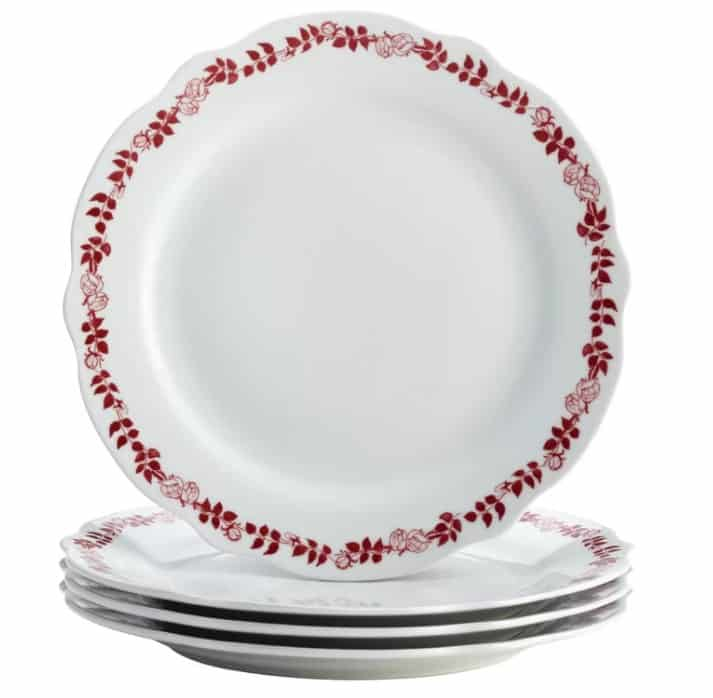 Inspired by old-fashioned illustration craft, this heirloom-quality plate set includes four dinner plates crafted from durable porcelain fine stoneware, each boasting festive red designs against gleaming winter white.