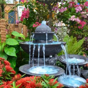 A stone, cascading fountain with multiple tiers.