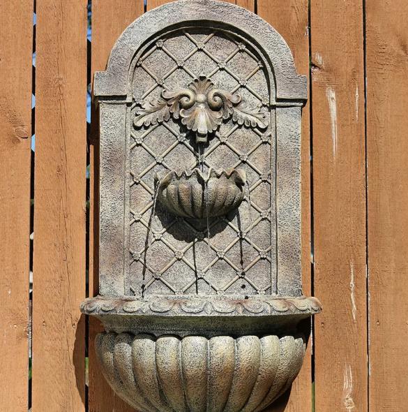 Gray, cascade wall fountain for outdoor use.