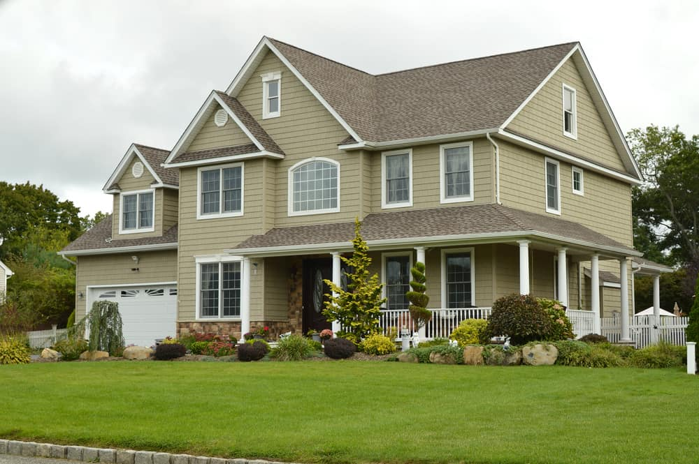 Brown green McMansion with white trim. Like grey, this is a safe house exterior paint color.
