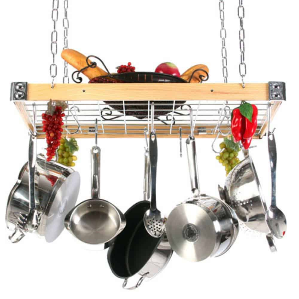Cookwares on a hanging wood frame pot rack with metal grid.