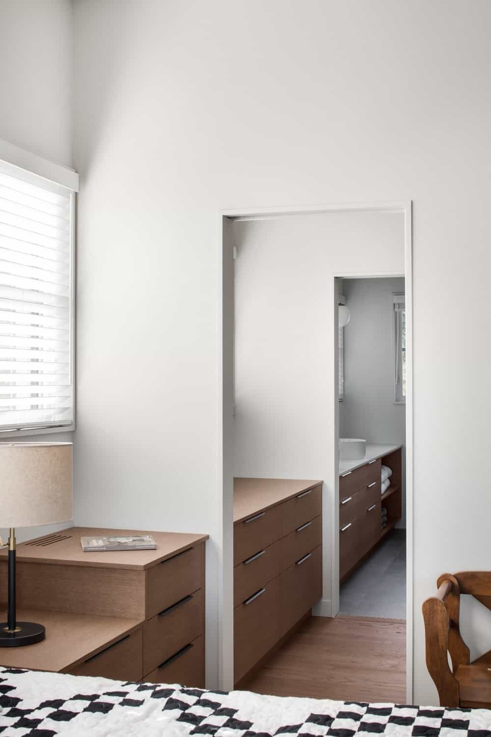 There's a hallway from the bedroom leading to the bathroom. Photo credit: Adrien Williams