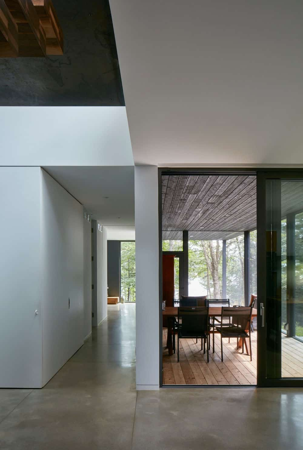 There's also a private dining room in the house with a hardwood flooring and glass walls. Photo Credit: James Brittain