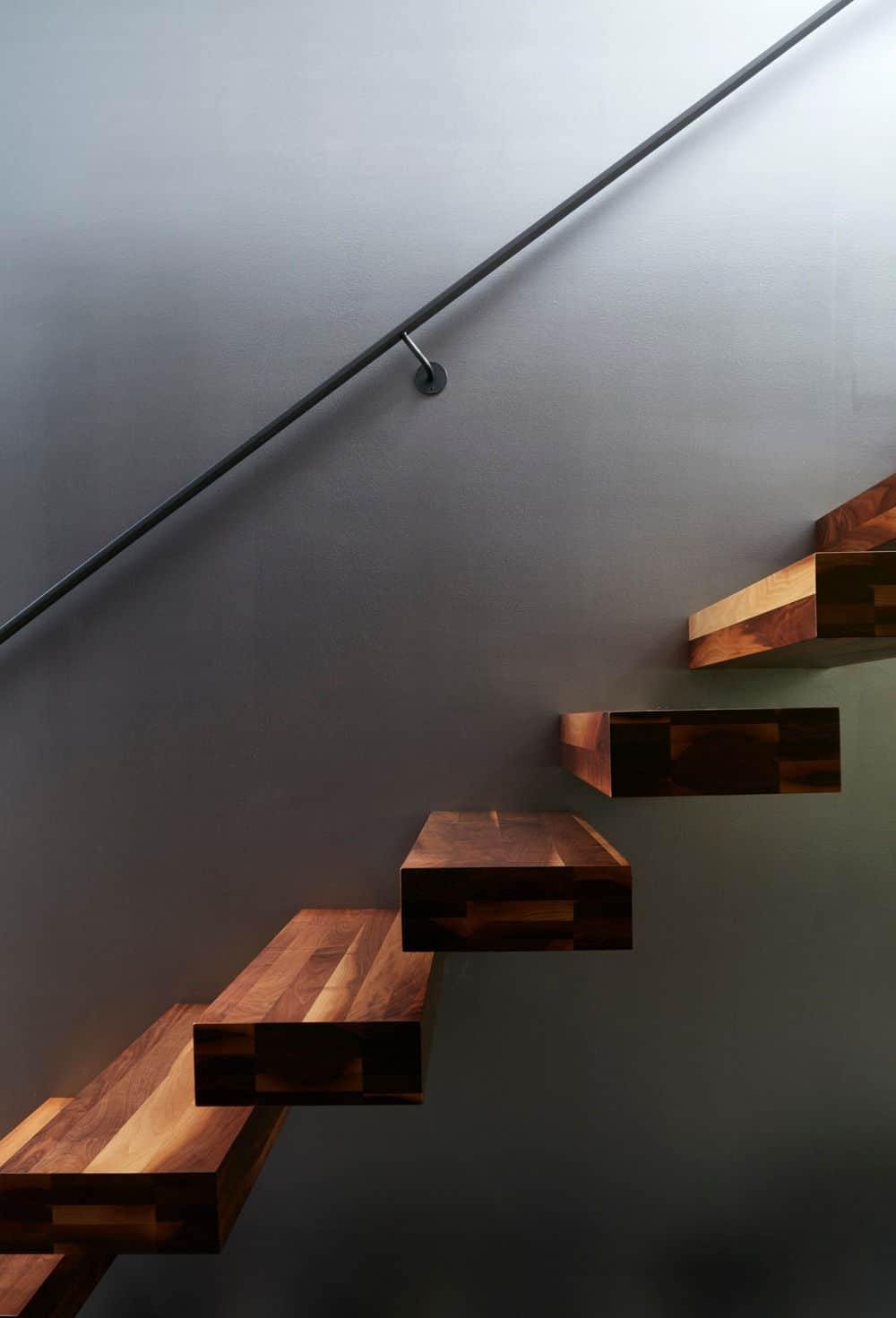 The staircase looks floating because of the architecture style. Photo Credit: James Brittain